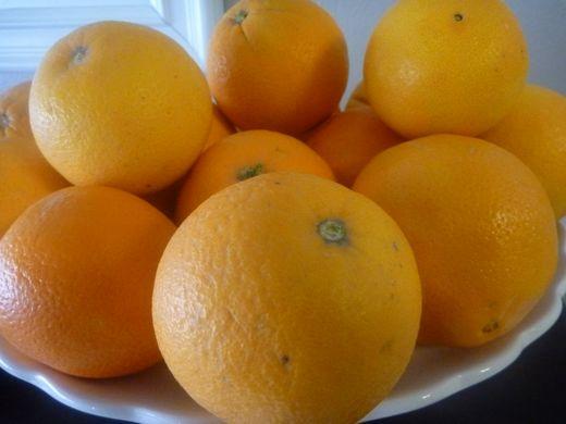 Eating Peel of Orange Peel an Orange