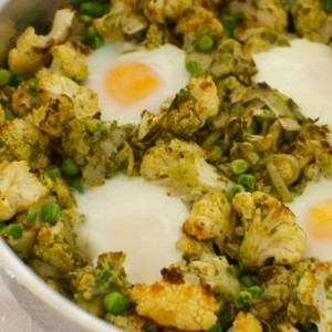 Baked Eggs with Roasted Cauliflower, Peas and Pesto